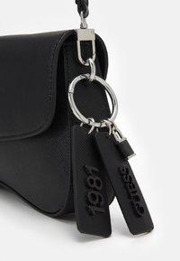 Guess - CORDELIA FLAP SHOULDER - Handbag - black - 3