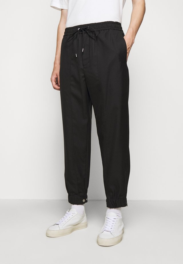 SERGE - Tracksuit bottoms - black
