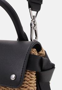 KARL LAGERFELD - IKON MINI TOP HANDLE - Across body bag - natural/black - 4