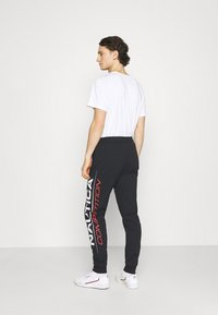 NAUTICA COMPETITION - PINISI - Tracksuit bottoms - black - 0