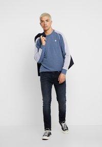 Junk De Luxe - HYDROLESS - Jeans Skinny Fit - shadow wash - 1