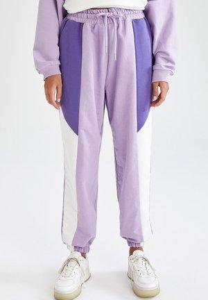 STANDART FIT - Tracksuit bottoms - purple