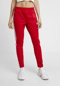 adidas Originals - Tracksuit bottoms - scarlet - 0