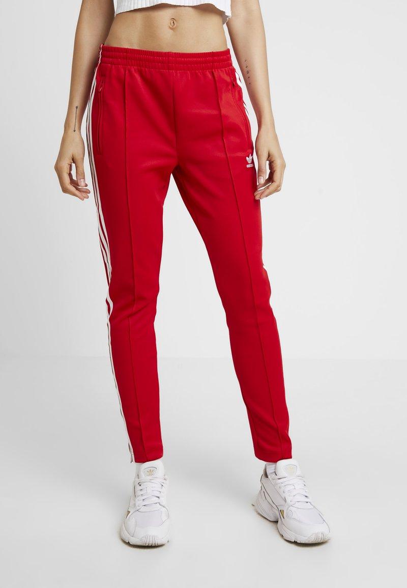 adidas Originals - Tracksuit bottoms - scarlet