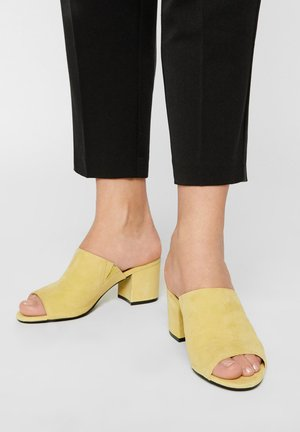 BIACATE - Heeled mules - light yellow