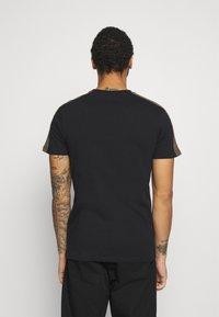 Ellesse - CARCANO - T-shirt z nadrukiem - black - 2
