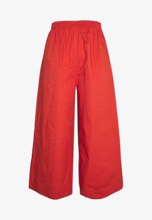 DINO - Trousers - terracotta
