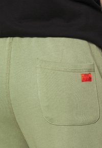 Diesel - PETER TROUSERS - Tracksuit bottoms - olive - 4