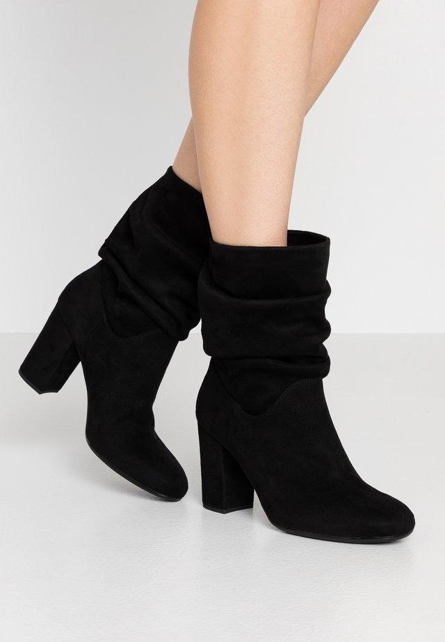 OLISE - Stiefelette - black