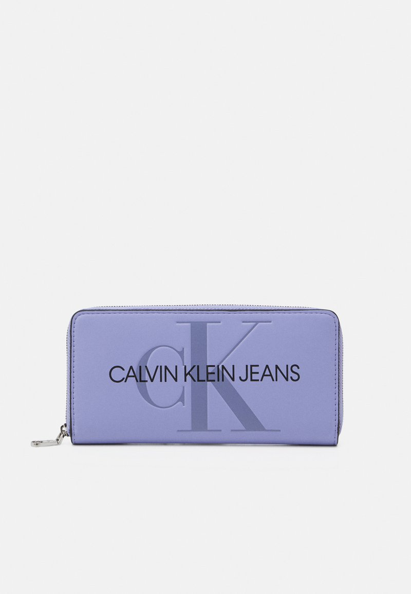 Calvin Klein Jeans - ZIP AROUND - Peněženka - purple