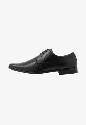 THATCHER - Elegantní šněrovací boty - black
