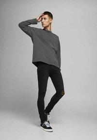 Jack & Jones - LIAM - Jeans Skinny Fit - black denim - 1