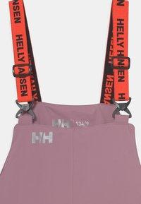 Helly Hansen - RIDER UNISEX - Talvihousut - light pink - 2