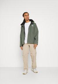 The North Face - SANGRO JACKET - Hardshell jacket - mottled green - 1