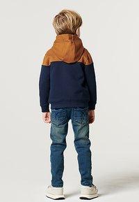 Noppies - BOOSTER - Sweater met rits - black iris - 1