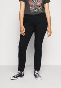 Vero Moda Curve - VMMANYA  - Slim fit jeans - black - 0