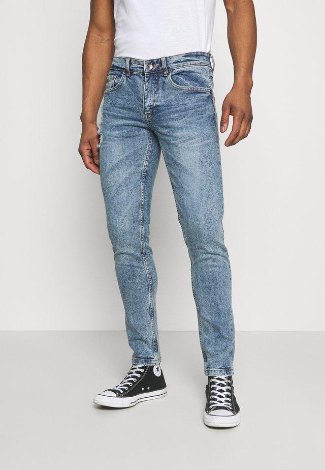 STOCKHOLM DESTROY - Jeans slim fit - pearl blue
