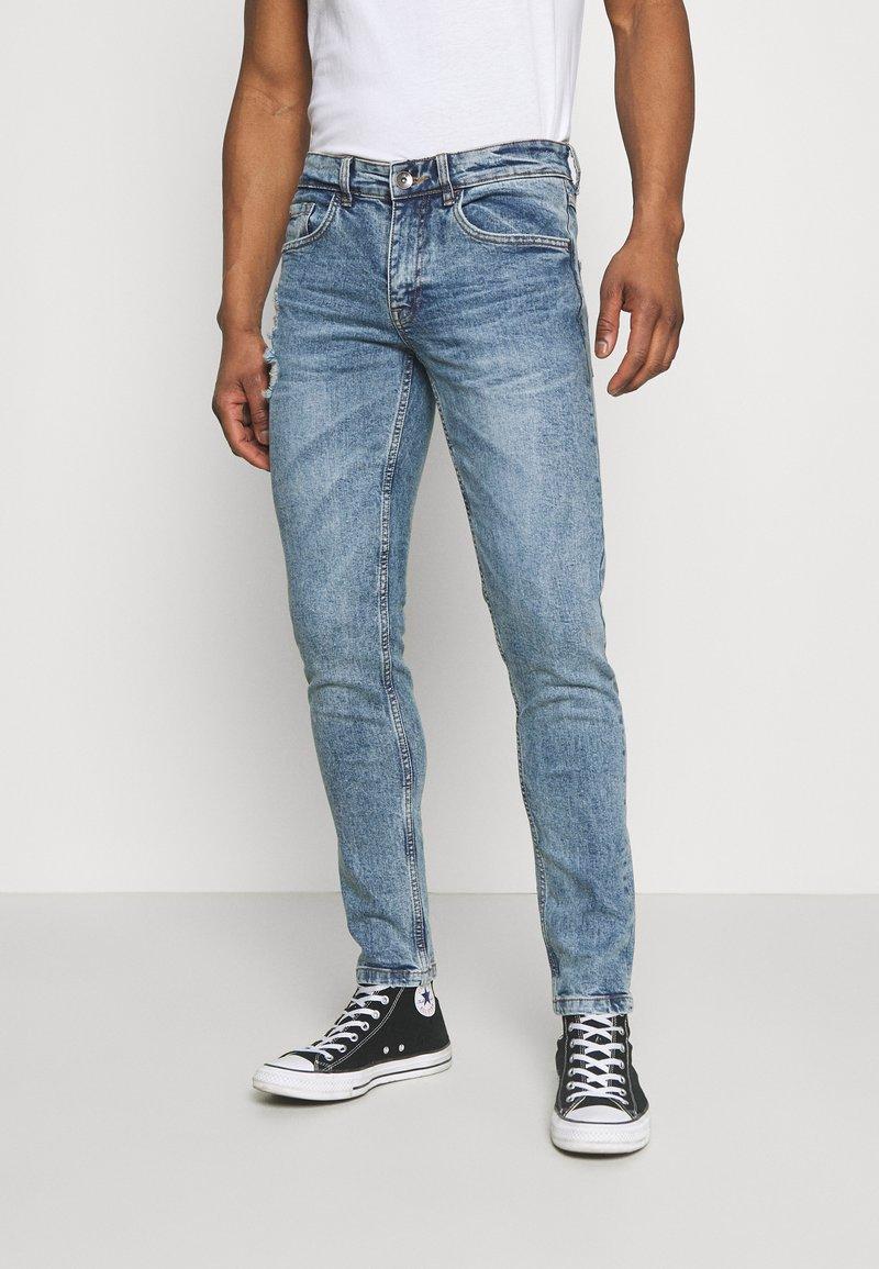 Redefined Rebel - STOCKHOLM DESTROY - Slim fit jeans - pearl blue