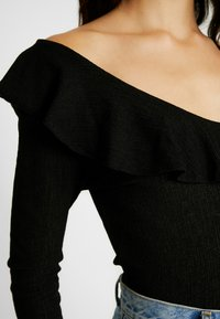Nly by Nelly - POWERFUL FRILL - T-shirt à manches longues - black - 5