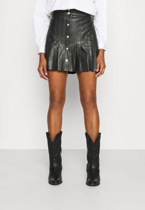 ECOLIERE - Mini skirts  - noir
