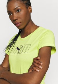 Puma - REBEL GRAPHIC TEE - T-shirt con stampa - sharp green/black - 4
