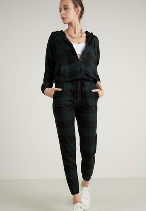 Tracksuit bottoms - schwarz - black/pine green tartan check