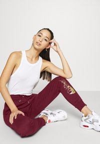 Nike Sportswear - PANT - Tracksuit bottoms - dark beetroot/metallic gold - 3