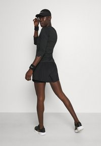 Nike Performance - SHORT - Sports shorts - black/white - 2