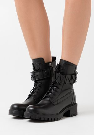 ANFIBIO CON LOGO LETTERING - Lace-up ankle boots - nero