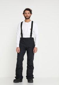 Brunotti - FOOTSTRAP MEN SNOWPANTS - Snow pants - black - 0