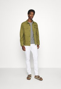 Tommy Jeans - CARGO JACKET - Summer jacket - uniform olive - 1
