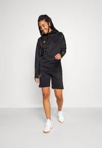 Hummel - CIMA XK SHORTS WOMAN - Sports shorts - black - 1