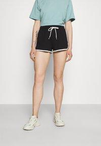 Monki - Pantaloni sportivi - blue/black - 1