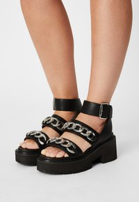 Buffalo - VEGAN ROCKET - Platform sandals - black - 0