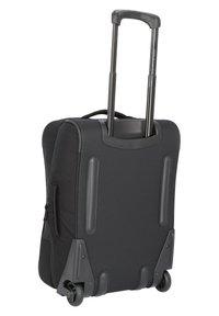 Dakine - CARRY  - Wheeled suitcase - black - 1