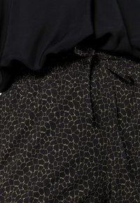 Opus - MELPIN MINIMAL - Trousers - black - 4