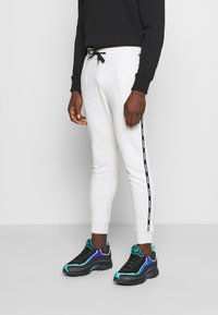 Hollister Co. - SPORT BABY TAPE JOGGER - Tracksuit bottoms - grey - 0
