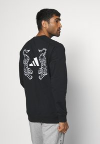 adidas Performance - TIGER CREW - Sweatshirt - black - 0