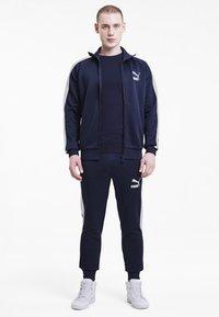 Puma - ICONIC  - Training jacket - peacoat - 1