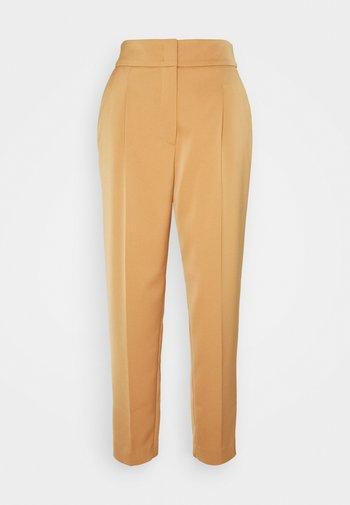 Trousers - creme caramel
