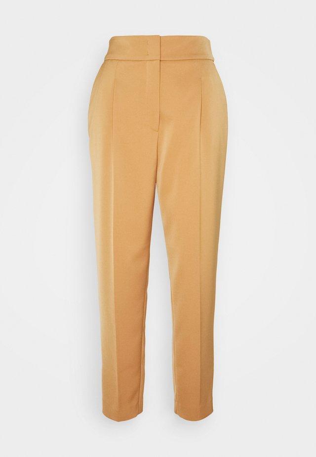Pantalones - creme caramel