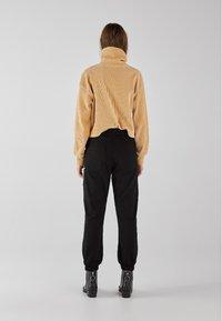 Bershka - Trousers - black - 6