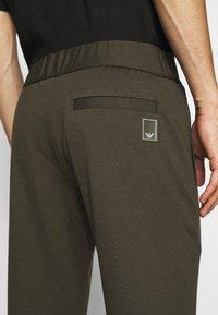Emporio Armani - JEZZ - Trousers - dark green - 5