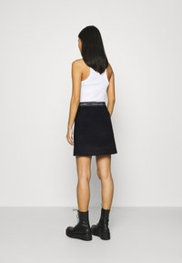 Calvin Klein - DOUBLE FACE SKIRT - Mini skirt - black - 2
