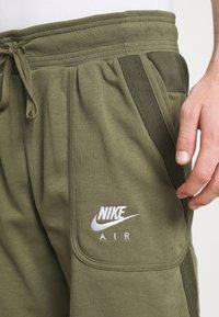 Nike Sportswear - AIR - Tracksuit bottoms - medium olive/cargo khaki/white - 3