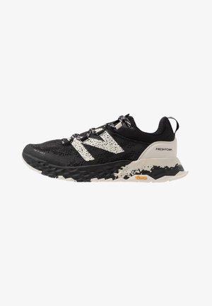 HIERRO V5 - Trail running shoes - black