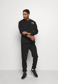 Puma - CREW - Sweatshirt - black - 1