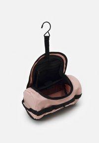 The North Face - TRAVEL CANISTER UNISEX - Wash bag - light pink/black - 3