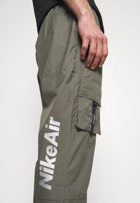 Nike Sportswear - AIR PANT  - Tracksuit bottoms - twilight marsh - 5