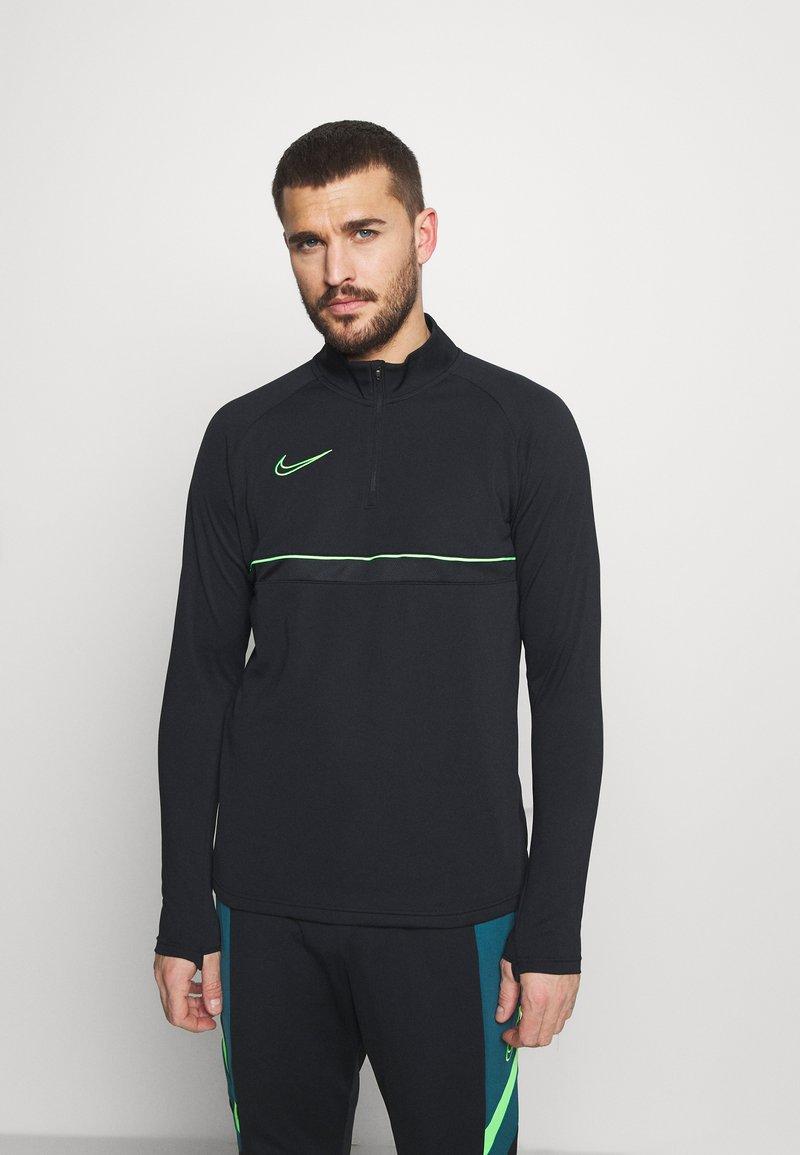 Nike Performance - Sports shirt - black/green strike